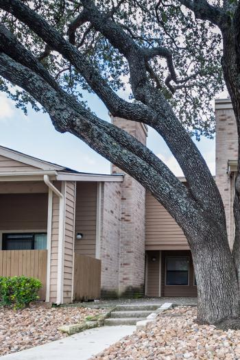 Apartment building exterior at Woods of Elm Creek in San Antonio