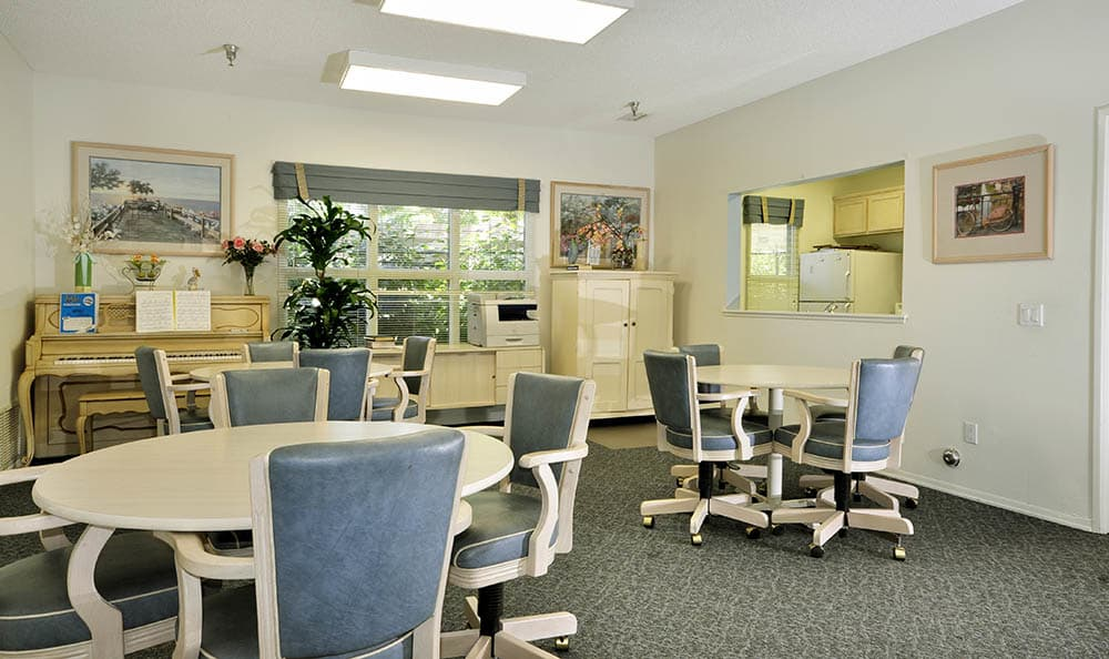 Clubhouse With Tables And Chairs at Cypress Meadows Senior Apartments in Ventura, CA