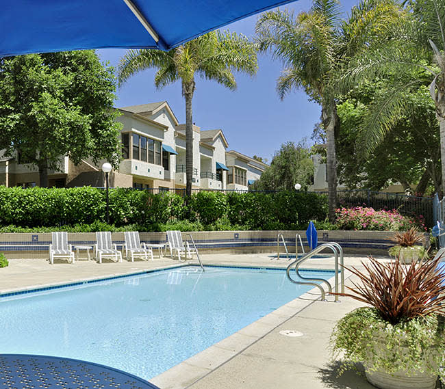 Cool off in our relaxing swimming pool at Cypress Meadows Senior Apartments