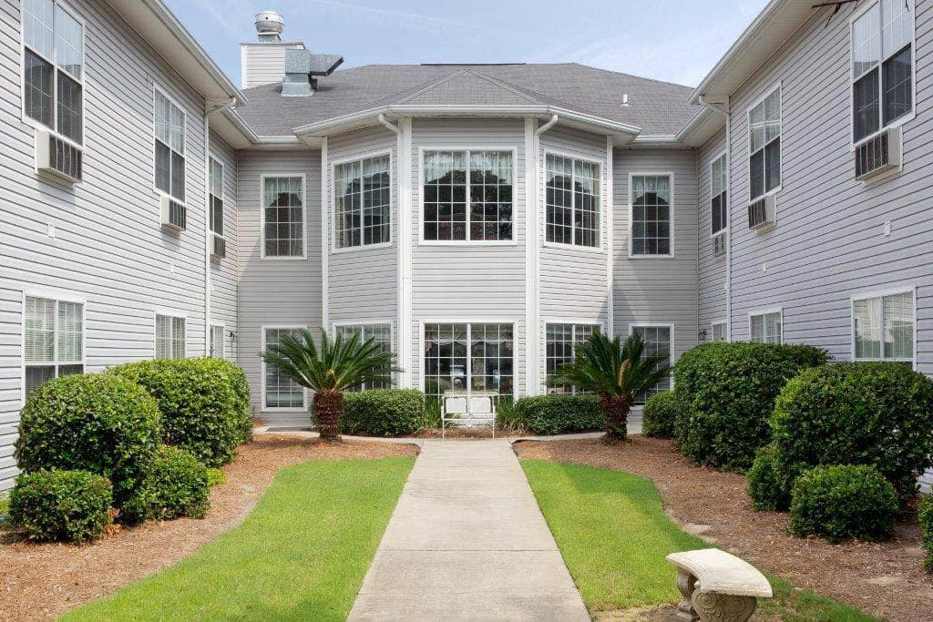Exterior Courtyard Bay Windows at Summer Breeze Senior Living in Savannah, GA
