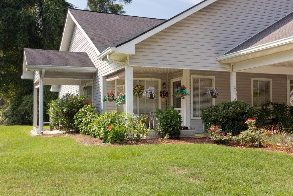 Landscaped Cottage Exterior at Summer Breeze Senior Living in Savannah, GA