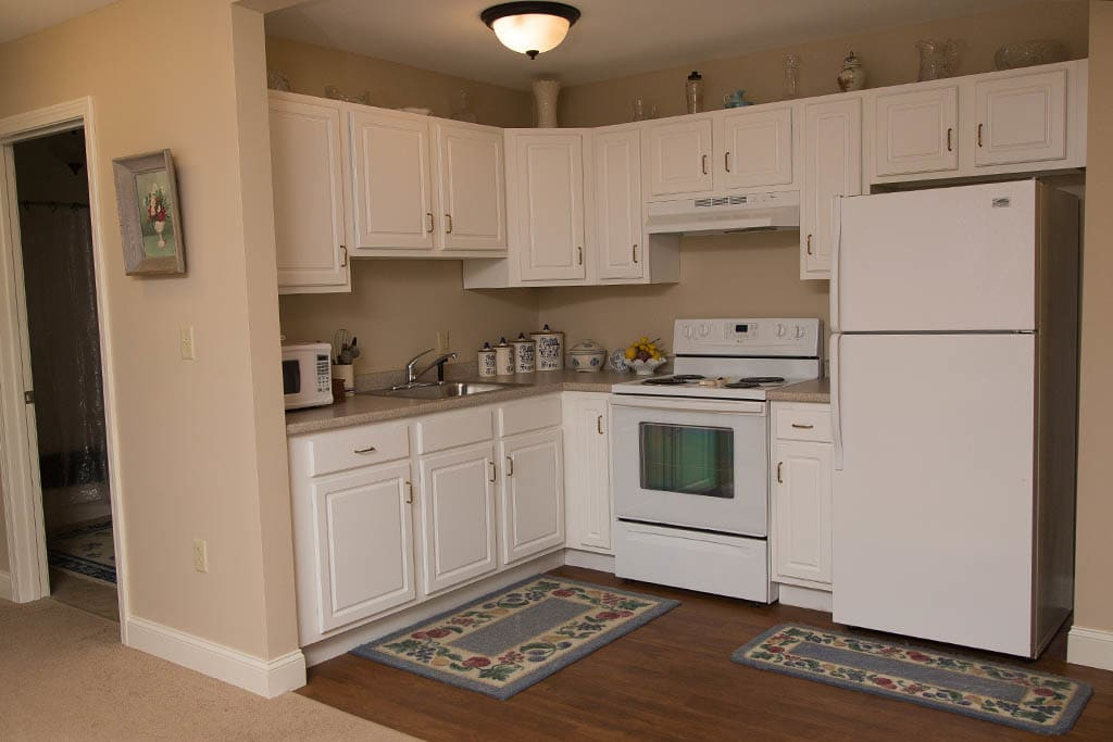 Spacious kitchen area in our apartments at Bentley Commons at Keene in Keene