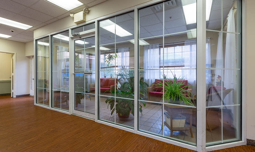 Sunroom With Plants And Fish tank at Ivystone Senior Living in Pennsauken, NJ