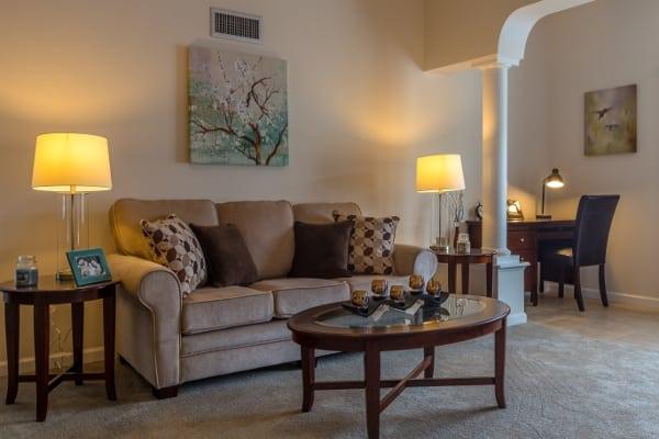 Well-lit living room of Stonebrook Village at Windsor Locks