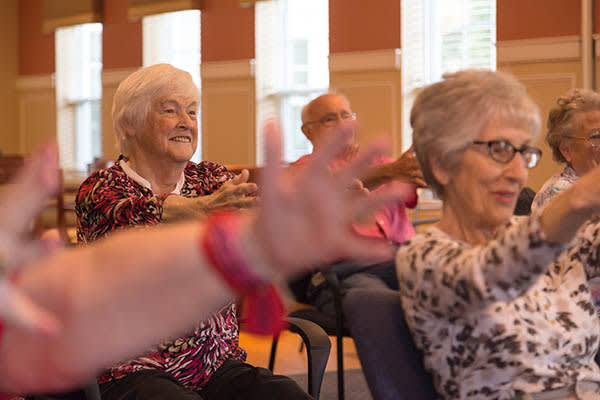 Join an activity with other residents at All American Assisted Living at Hillsborough