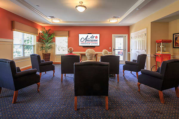 Take in a movie with friends at All American Assisted Living at Londonderry
