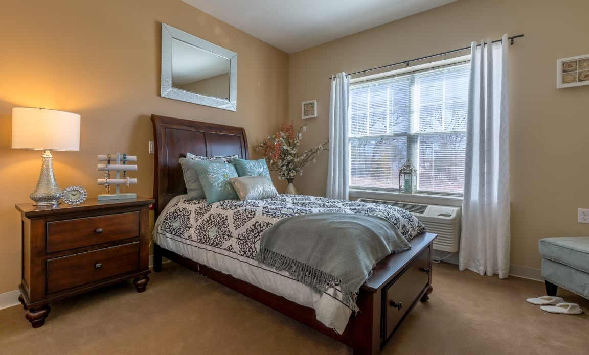 Spacious bedroom at All American Assisted Living at Wrentham in Wrentham, MA