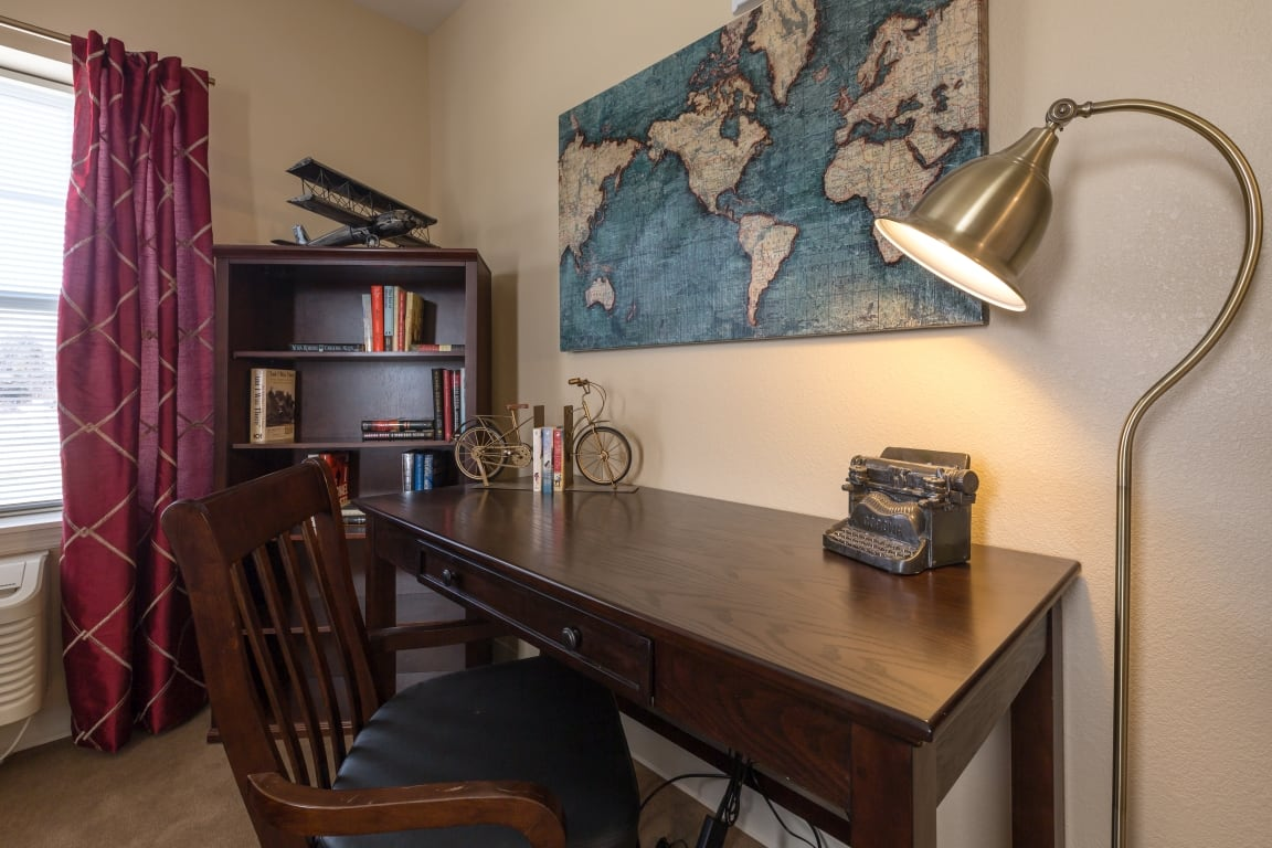 Desk and reading lamp at All American Assisted Living at Wrentham in Wrentham