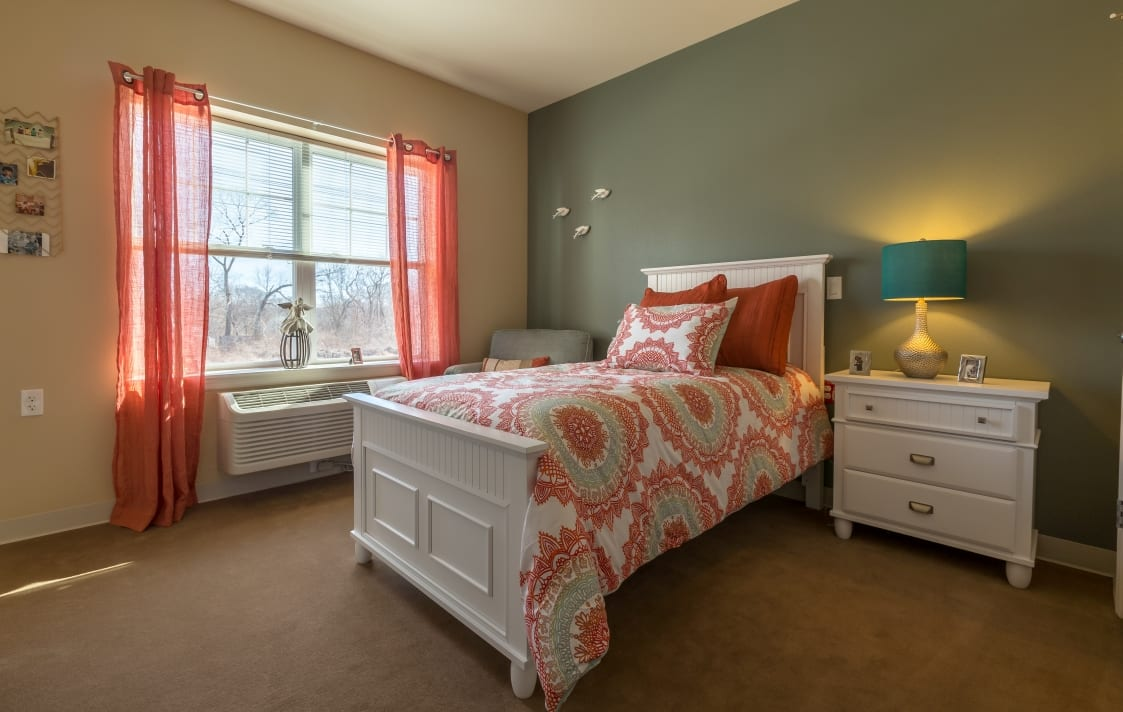 Brightly colored bedroom at All American Assisted Living at Wrentham in Wrentham