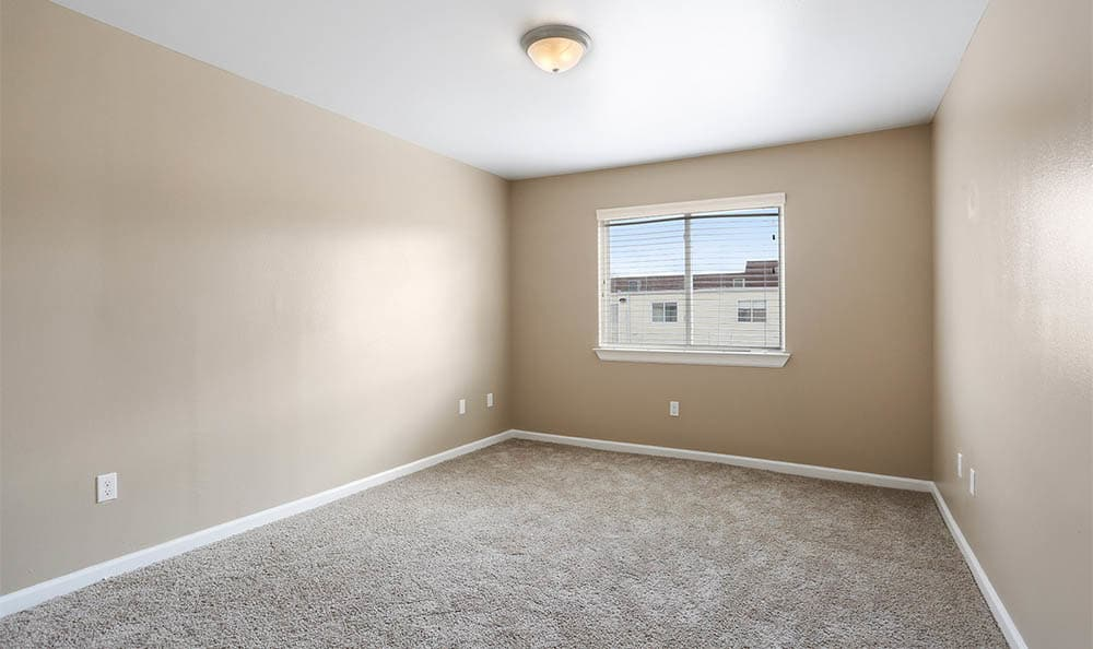 Carpeted Bedroom At The Mayfair Apartment Homes