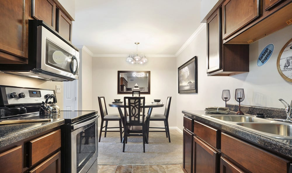 Kitchen and Dining at Emerald Pointe Apartment Homes