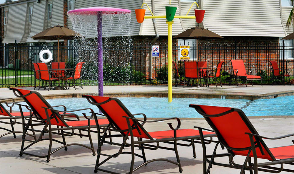 Water Fountains In The Pool At Emerald Pointe Apartment Homes