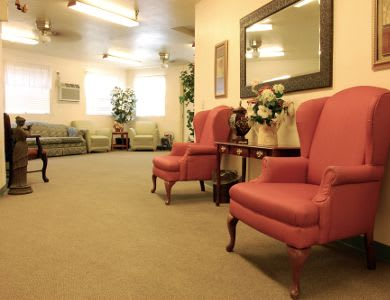 Comfortable chairs in a common space at Valley Crest Memory Care in Apple Valley, CA