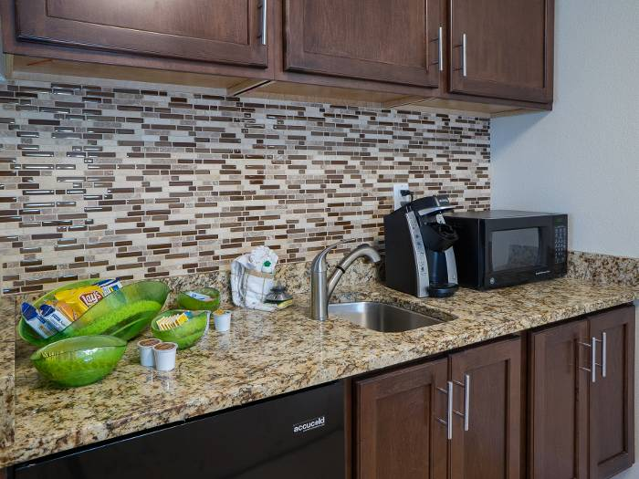 Kitchen with tiled backsplash in a senior living apartment at The Meridian at Westwood