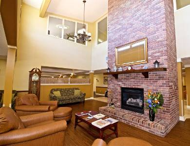 Beautiful living room with a fireplace in Sun City Senior Living