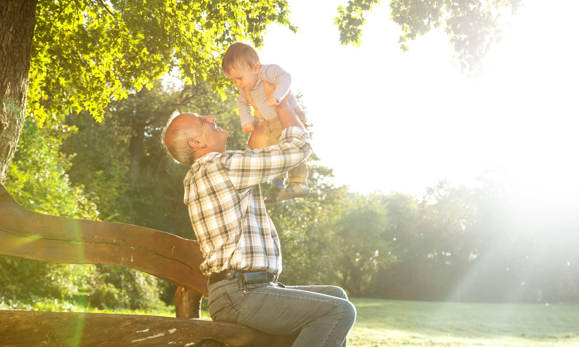 Man holding grandchild at St. Andrews Memory Care