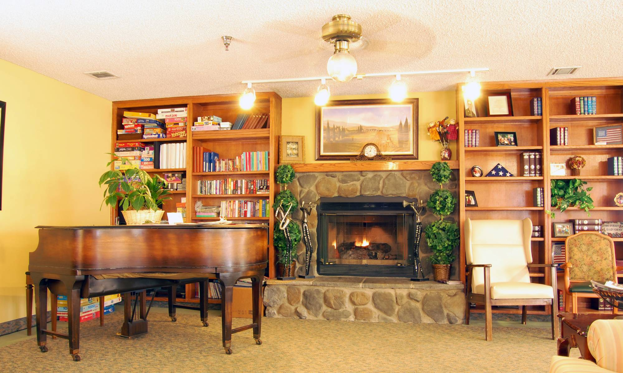 Beautiful living room with a piano at Sierra Vista Independent and Assisted Living