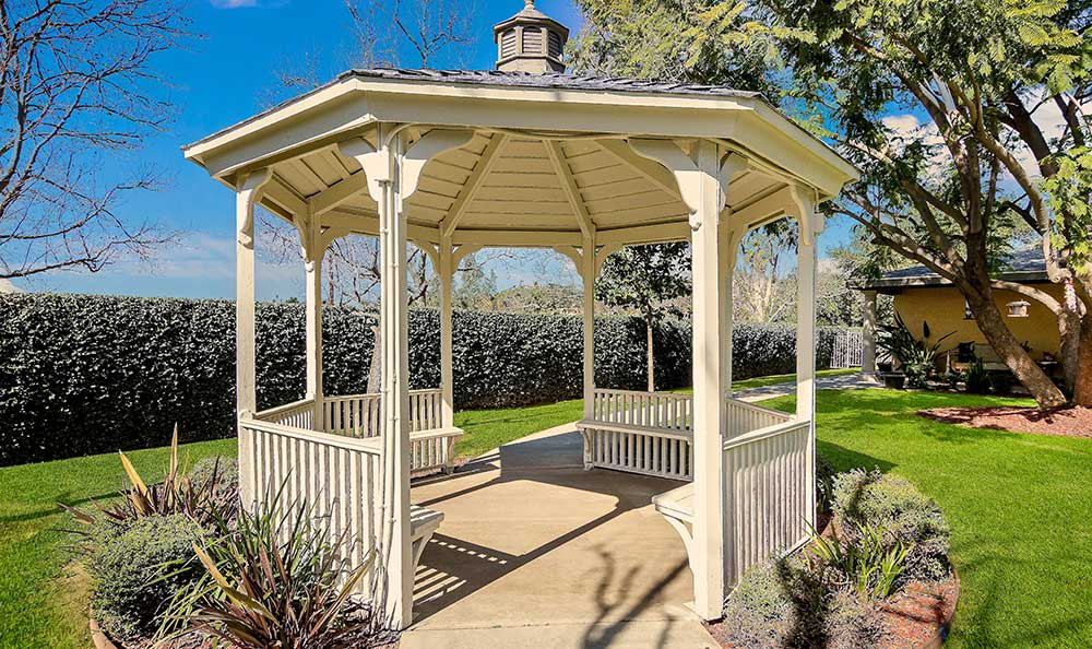 Garden with gazebo at Pacifica Senior Living: Riverside Legacies Memory Care