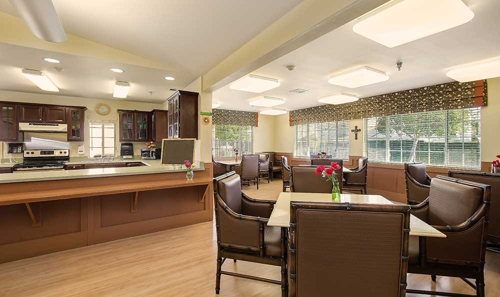 Kitchen and dining area at Pacifica Senior Living: Riverside Legacies Memory Care