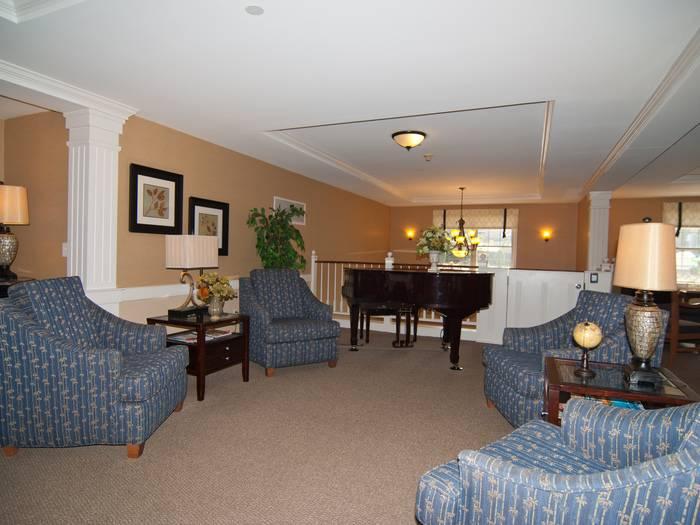Spacious living room at Pacifica Senior Living Victoria Court in Cranston, RI