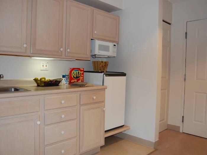 Senior apartment kitchen at Pacifica Senior Living Victoria Court in Cranston, RI