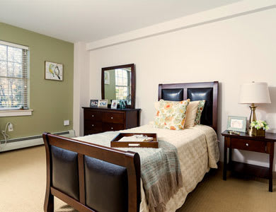 Bedroom at Pacifica Senior Living Victoria Court in Cranston, RI