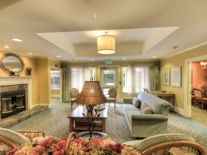 gorgeous living room with fireplace at Pacifica Senior Living Union City in Union City, CA