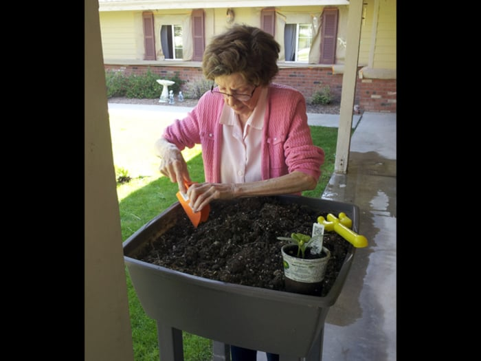 Resident at Pacifica Senior Living Tucson showing green thumb