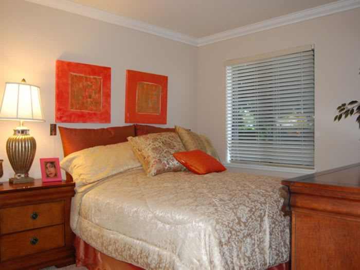 large, cozy bedroom at Pacifica Senior Living San Leandro in San Leandro, CA