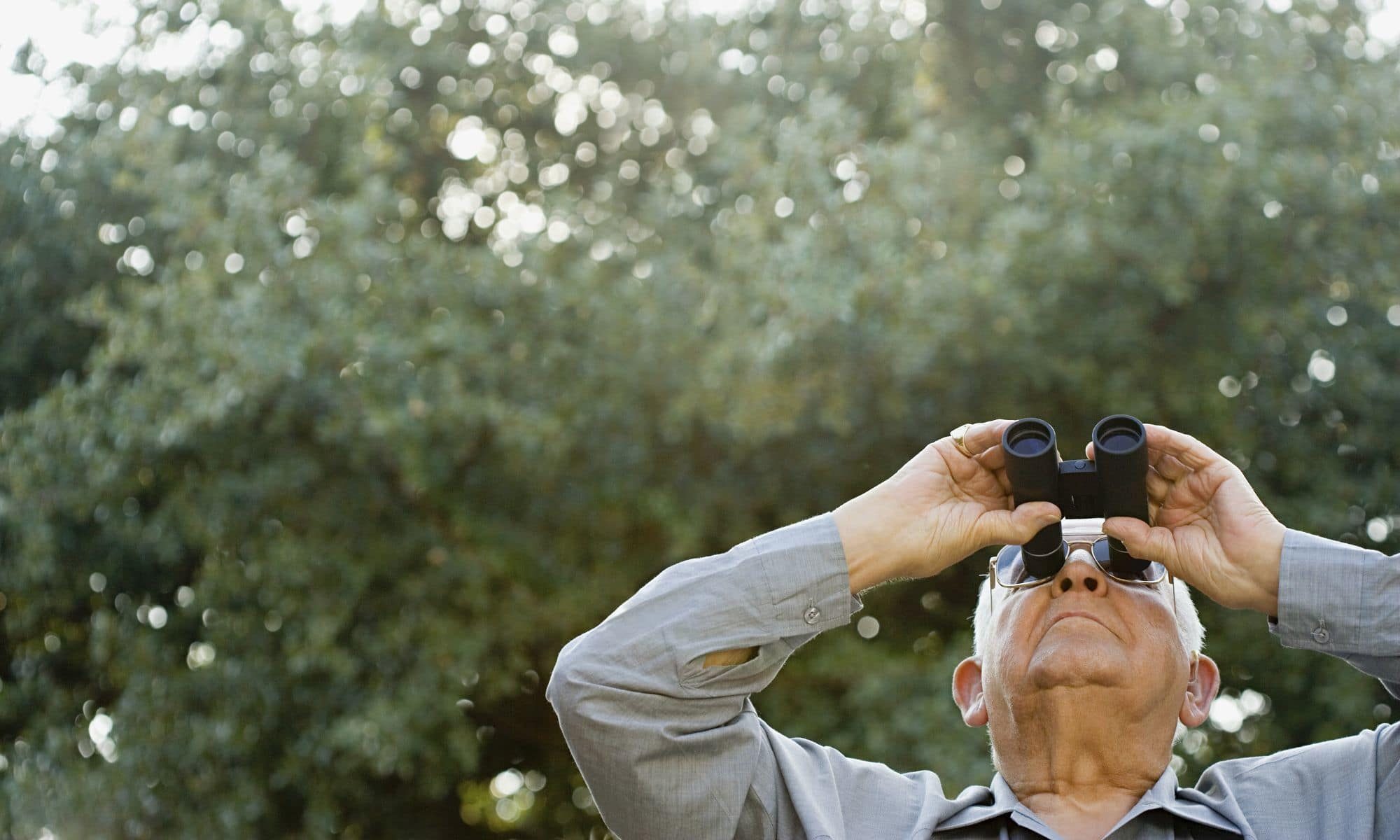 Man bird watching at Pacifica Senior Living Heritage Hills in Hendersonville