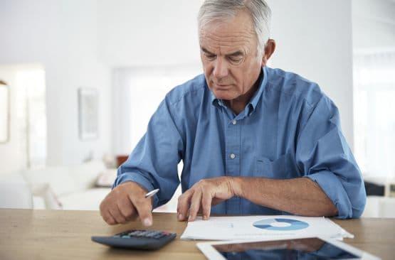 Senior living resident working on financial planning at Pacifica Senior Living
