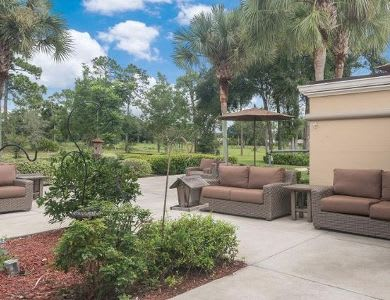 comfy couch in courtyard at Pacifica Senior Living Ocala