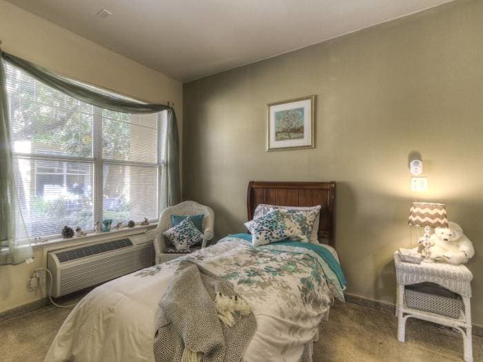 Well decorated bedroom at Pacifica Senior Living Modesto in Modesto