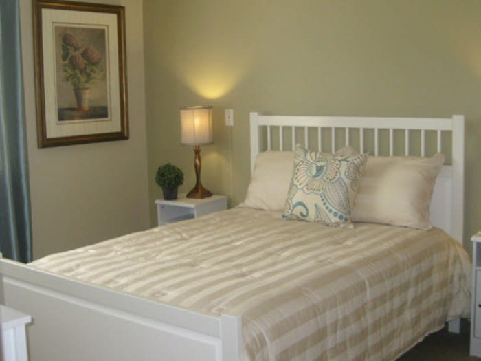 Cozy senior living bedroom at Pacifica Senior Living Millcreek