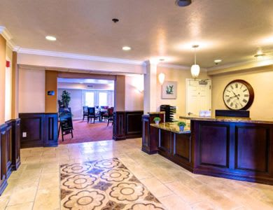 Hallway and reception area at Pacifica Senior Living Millcreek