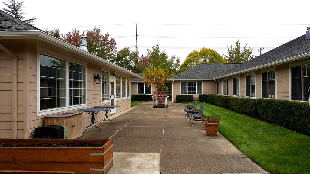 Building and walkways at Pacifica Senior Living McMinnville memory care facility