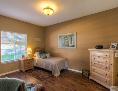 well decorated bedroom at Pacifica Senior Living Coeur d'Alene in Coeur d'Alene, ID