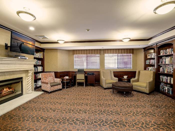 Cozy couches and fireplace at Pacifica Senior Living Chino Hills in California