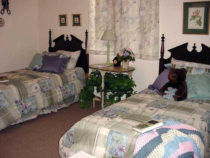 Comfortable bedroom in Pacifica Senior Living Belleair