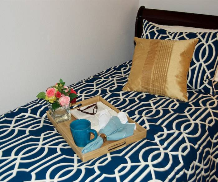 Relaxing senior living resident bedroom is the perfect place to read in peace in Lynnwood