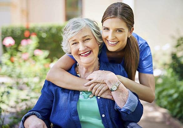 A senior resident at Pacifica Senior Living Country Crest with her caretaker