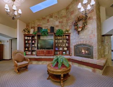 Gorgeous living room with a fireplace at Pacifica Senior Living Pinehurst