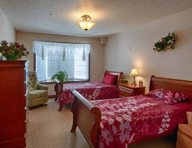 Well decorated bedroom at Pacifica Senior Living Pinehurst