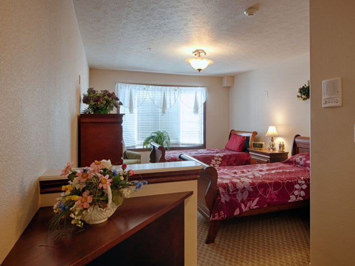 well decorated bedroom at Pacifica Senior Living Pinehurst in Pinehurst, ID