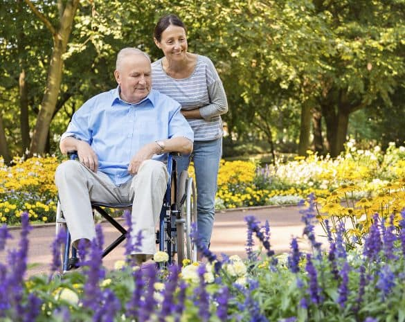 Staff member at our senior living facility in Vancouver on a walk with a resident
