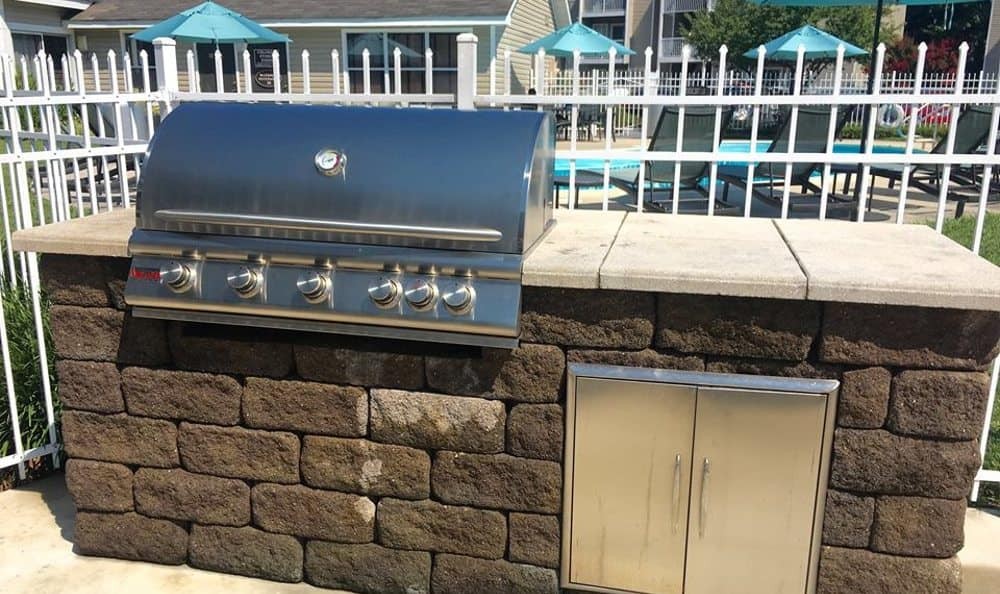 Stainless steel grill on the patio at Ashbrook Apartments in Virginia Beach