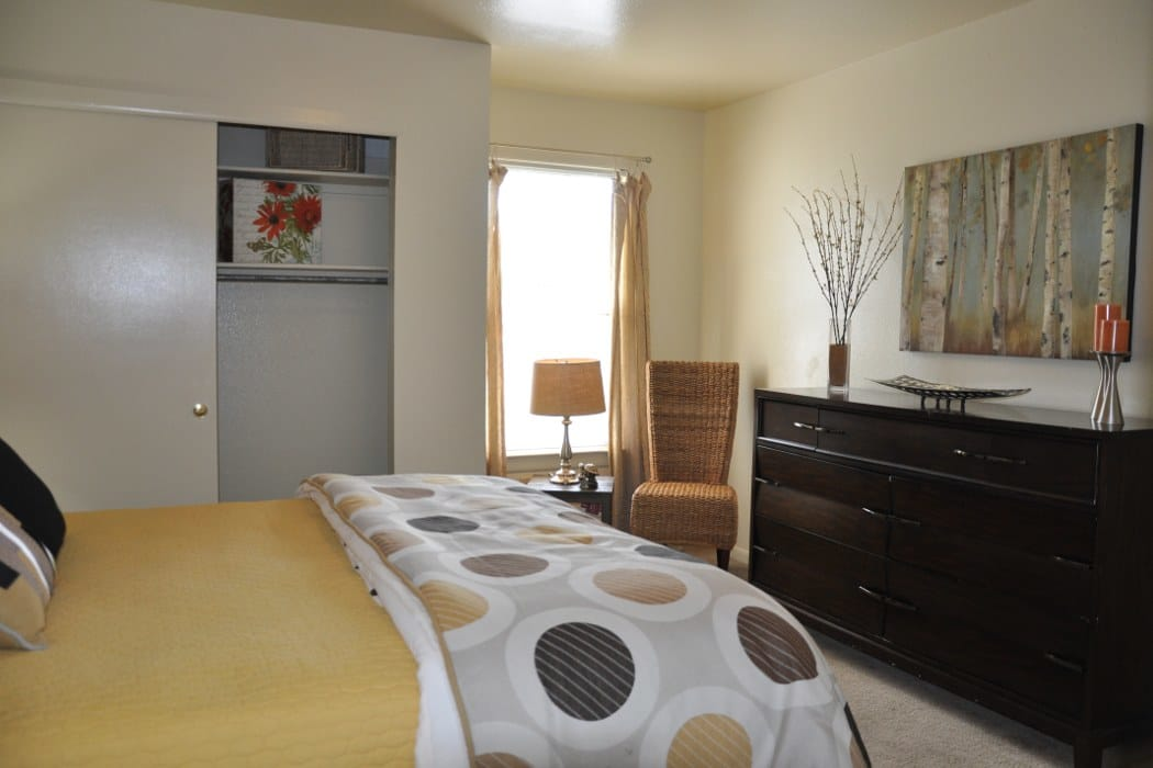 Well decorated master bedroom at The Townes at Jones Run in Newport News
