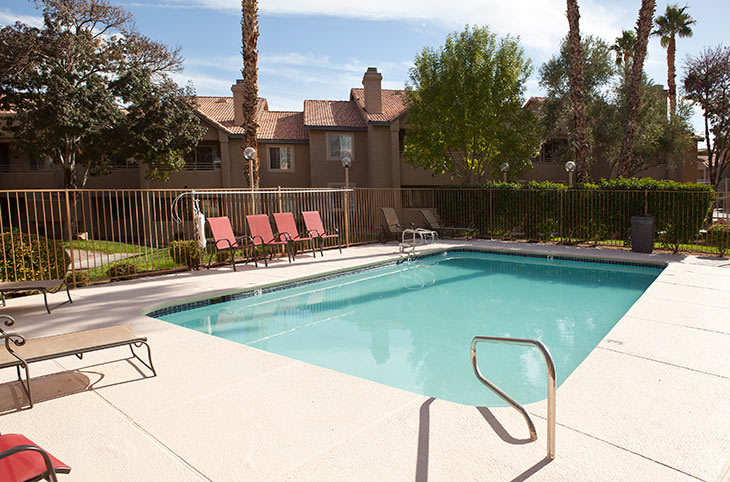 Relax in the swimming pool at Sunrise Springs Apartments in Las Vegas, Nevada