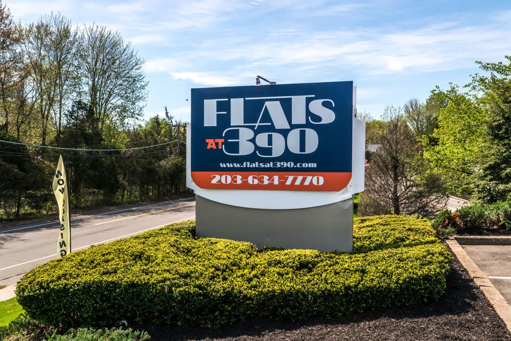 Flats at 390 street sign.