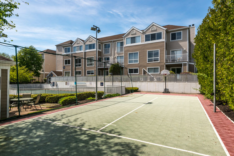 Residents enjoy the on-site gym & tennis at Flats at 390